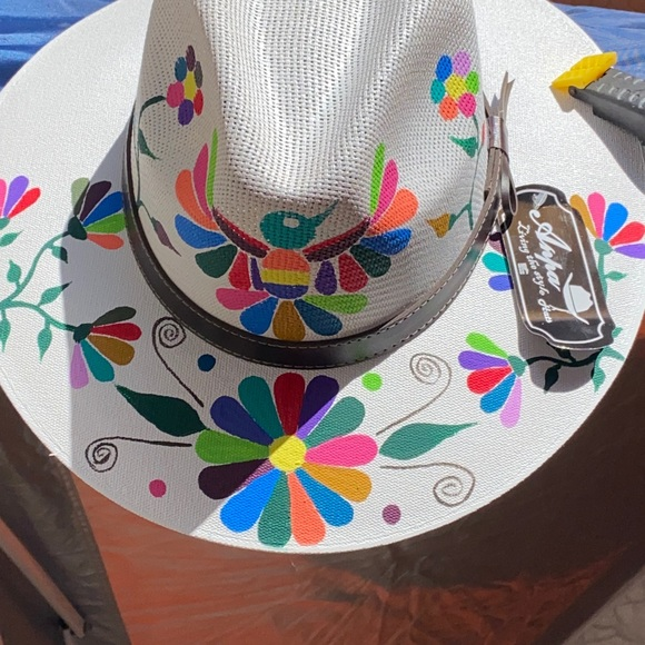 HATS hand painted by Edward from Cabo San Lucas.